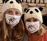 wearing a panda mask