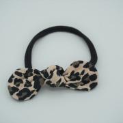 Zwarte haarband tricot leopard strik