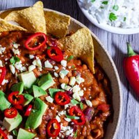 Over head view of Slow Cooker Bean chilli with rice and tortillas