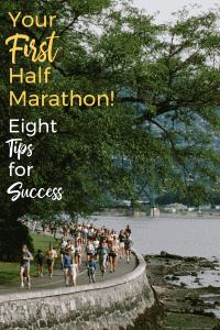 half marathon runners on a road near water