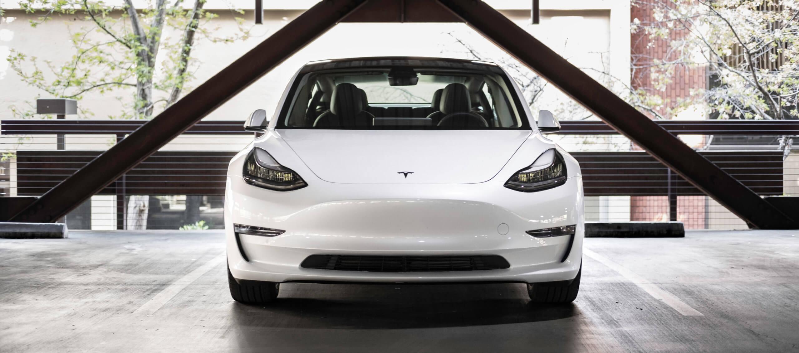 Automotive trends White Tesla Model 3 parked