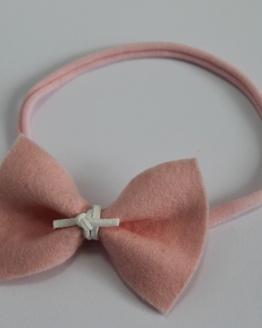 Roze nylon haarbandje roze vlinderstrik