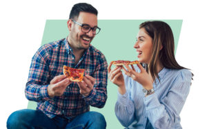 Speed date your spouse: Man and woman eat pizza and laugh