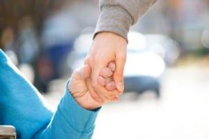Caregiver Holding Senior's Hand