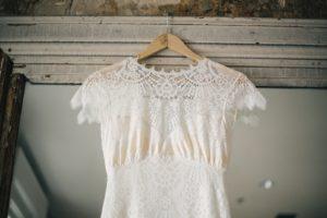 wedding dress on wooden hanger