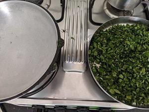 Dry roasting the moringa leaves