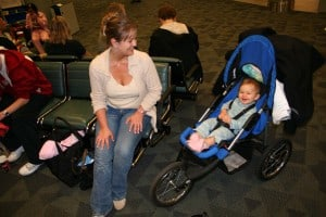 Travel With a Jogging Stroller, airport with baby, waiting in airport, airport stroller