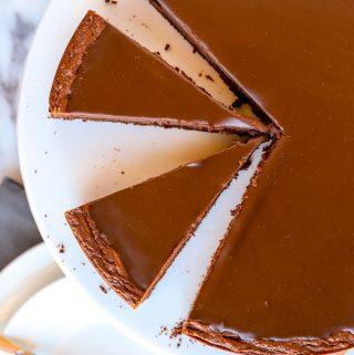 Overhead slices of flourless chocolate cake with chocolate ganache