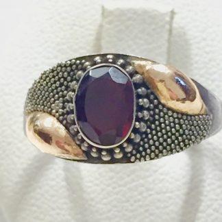 anello in oro e argento con granato