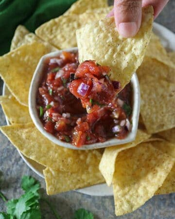 Tasty Chunky Easy Homemade Salsa on a corn tortilla chip.