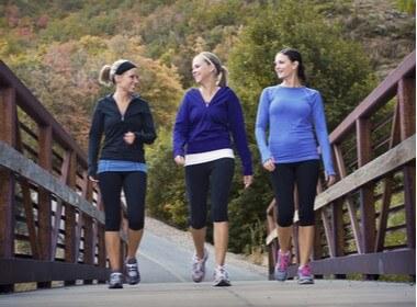 three women talking a walk together