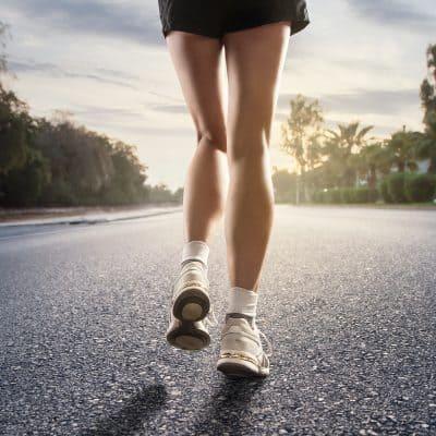 solo female runner social distancing on street