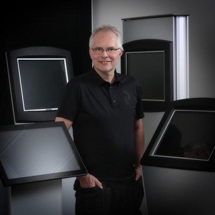 Johnny Tøstesen standing in front of kiosks