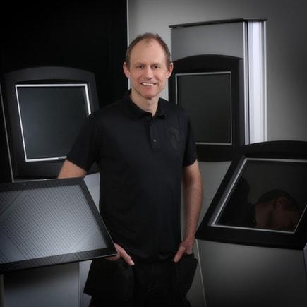 Michael Nielsen standing in front of kiosks