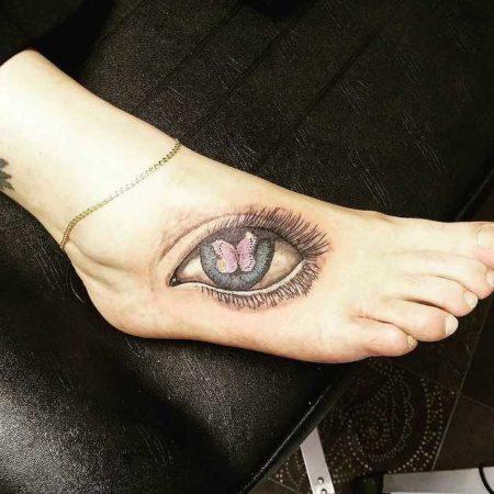 Глаз тату на ступне