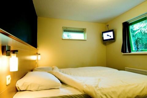 Bungalowpark De Roggeberg voorbeeld slaapkamer