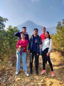 group of travelers posing during champadevi hiking
