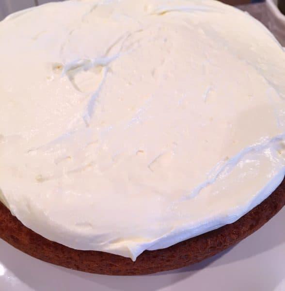 Spreading lemon filling over cake