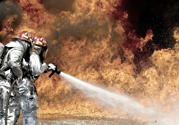 Image of firefighters tackling a tunnel fire.