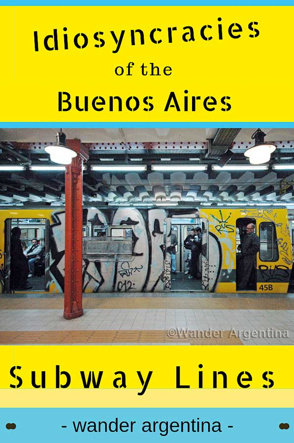 A picture of a graffitied Buenos Aires subway car in a subway station with the conductor hanging out the door and the words, 'Idiosyncracies of the Buenos Aires Subway lines' -Wander Argentina