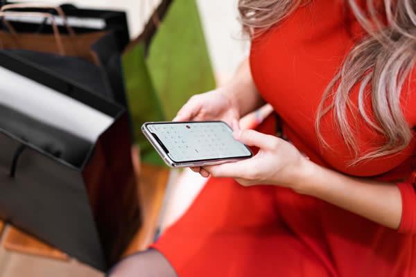 Woman using mobile app
