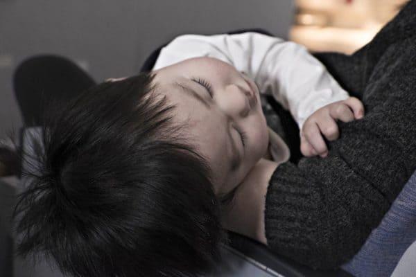 Toddler falling asleep in mom's lap