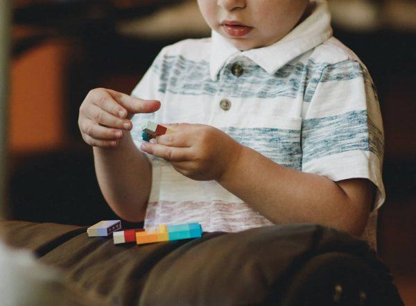 Boy building with lego