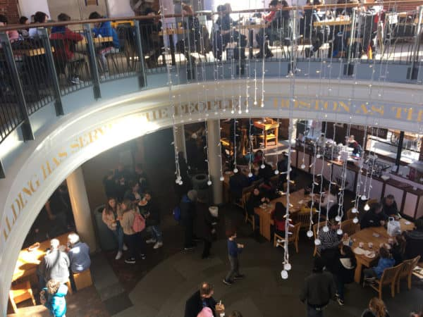 The busy two-story food hall at quincy market