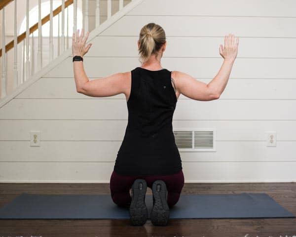 Lifestyle blogger Amanda Seghetti demonstrates scapular retraction and easy posture exercises