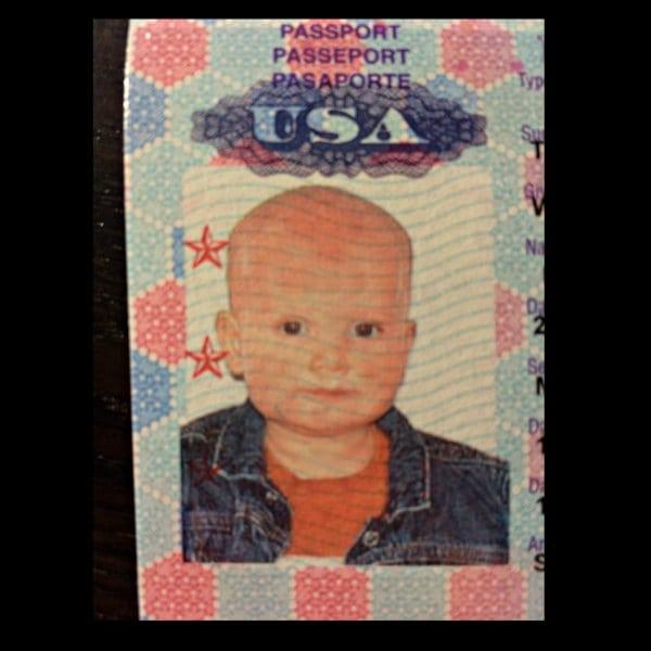 Not a 1950s gangster, my cute boy's first passport photo.