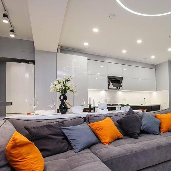 indoor kitchen lighting over grey couch