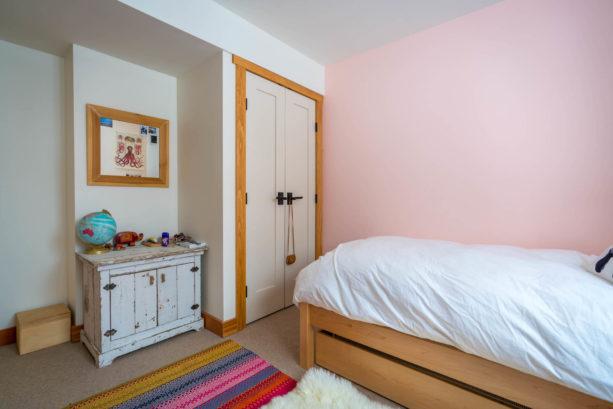 white custom closet doors paired with wooden interior trim