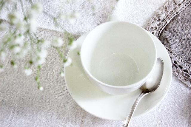 white ceramic tea cup