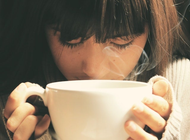 girl holding a cup of tea