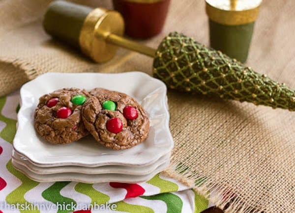 Holiday Truffle Cookies on a stack of white plates with Christmas decor