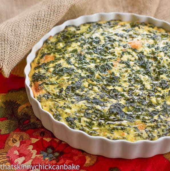 Spinach Souffle in a white ceramic baking dish