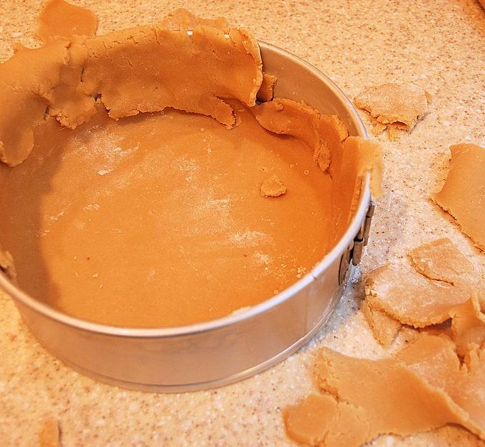 lining a tart pan with crumbly dough
