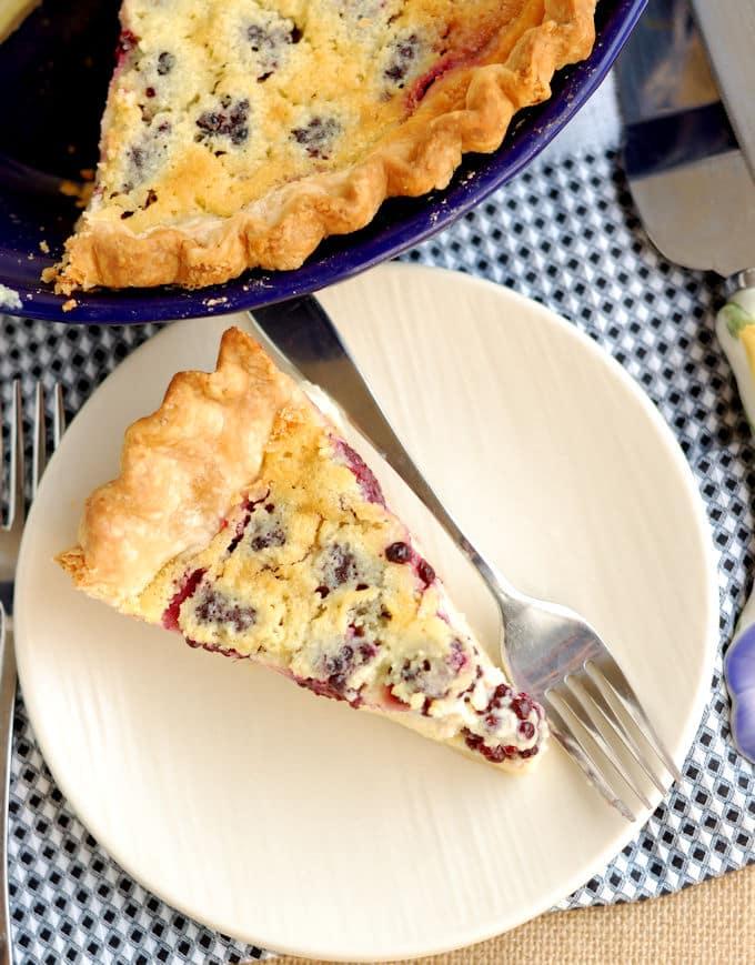 a slice of blackberry buttermilk pie