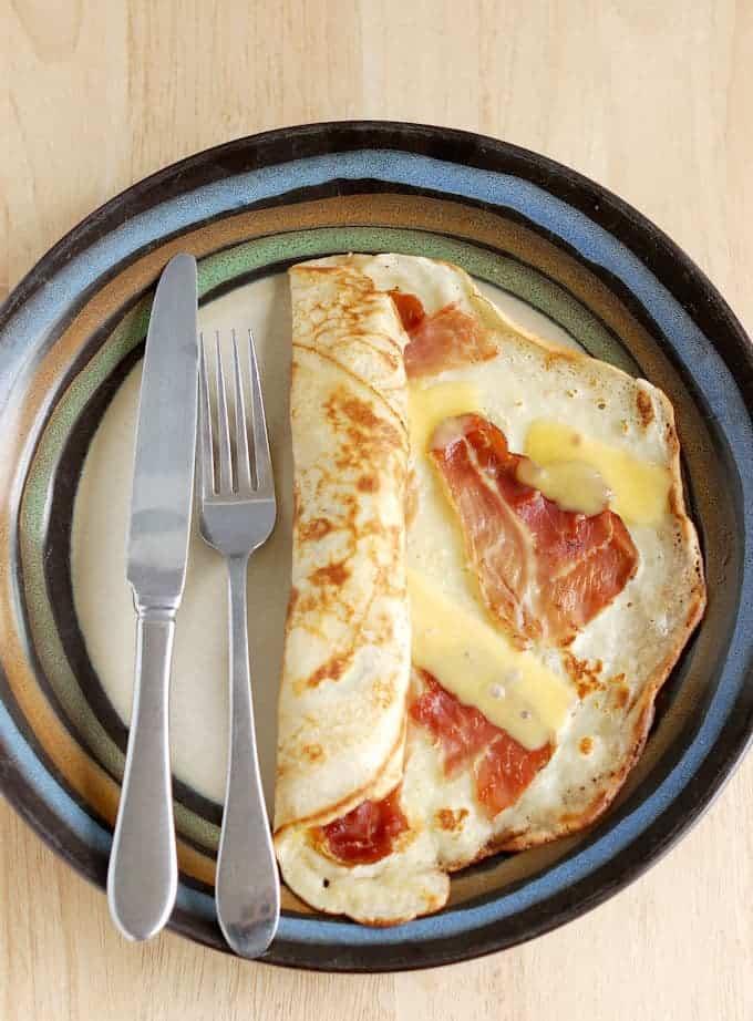 a Savory Dutch Pancake, pannekoeken, with speck and gouda.