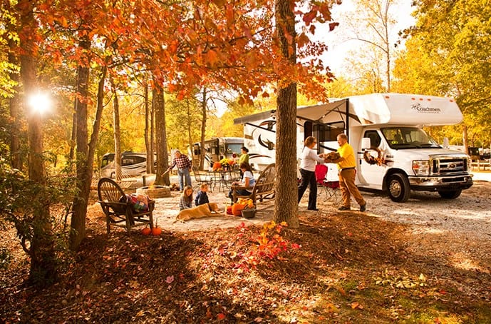 A family rv camping in the fall.