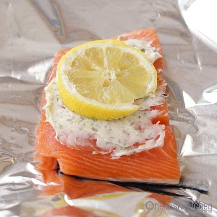 lemon and butter over raw salmon