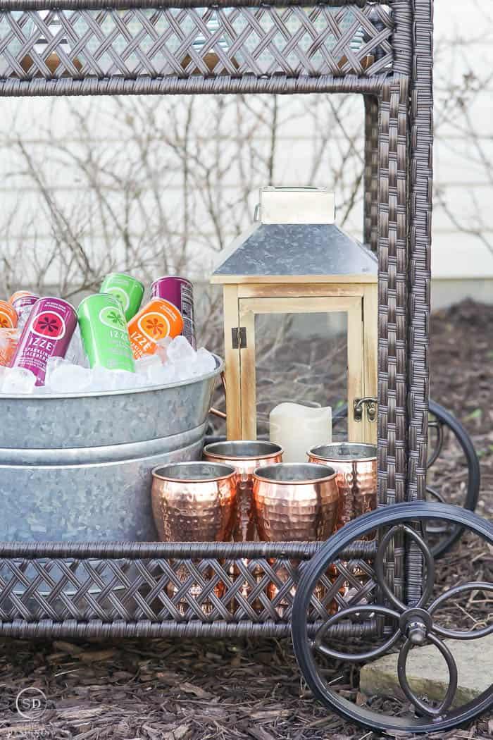 galvanized tub for drinks - solar lantern - hammered copper tumblers