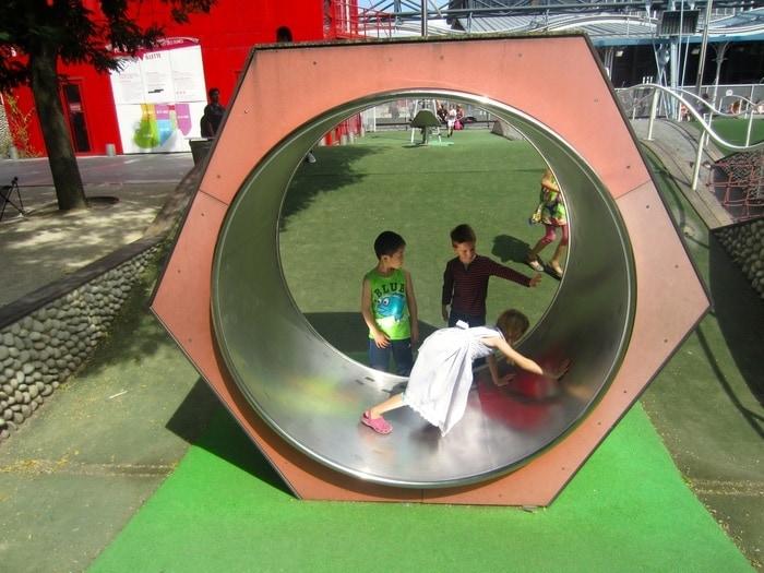A large wheel a the playground at parc de la villette