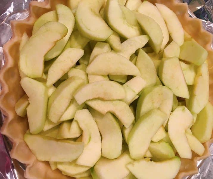 Fresh sliced apples in pie shell
