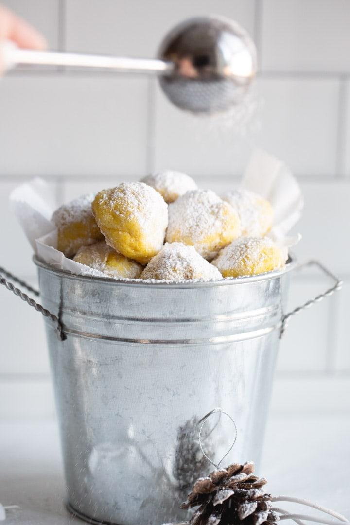 Lemon Snowball cookies in a metal bucket.