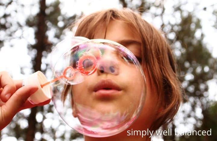 outdoor activities to help kids calm down: blowing bubbles