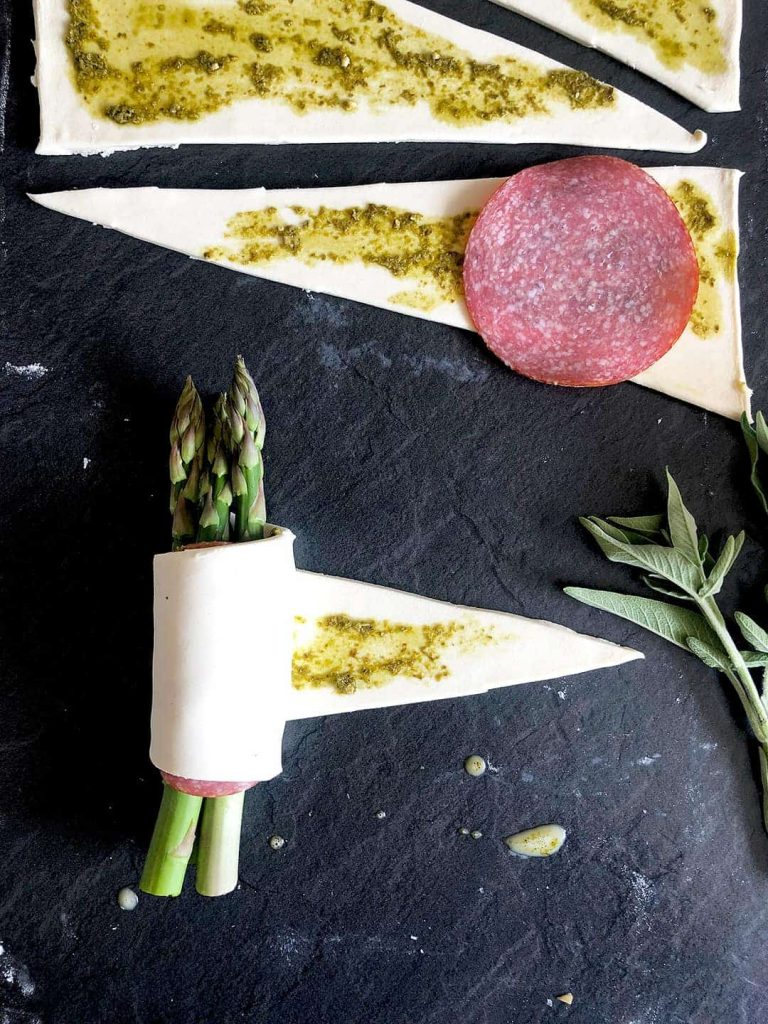 wrapping asparagus in puff pastry
