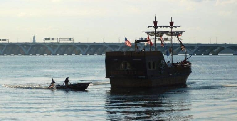 Urban pirates plunder national harbor, tailed by a pirate in an outboard skiff.