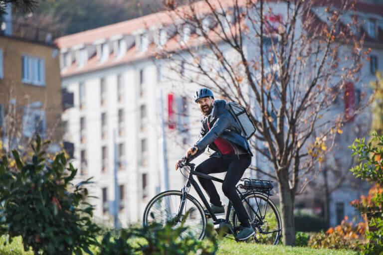 Business man riding his e-bike