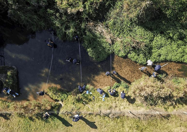 Birds eye view of pupils doing fieldwork at Rive Pang